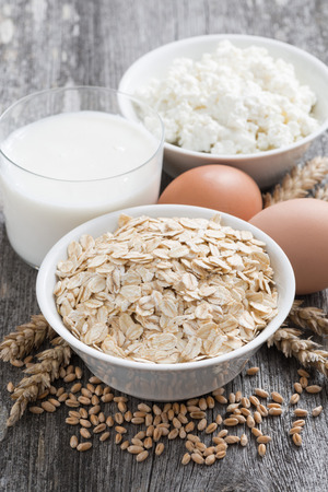 fresh dairy products - oatmeal, eggs, cottage cheese and milk, close-up photo