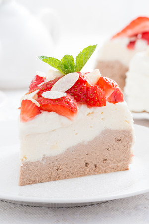 piece of cake with whipped cream and strawberries, close-up, vertical photo