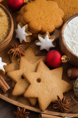 Assorted Christmas cookies, decorations and spices, top view, vertical photo