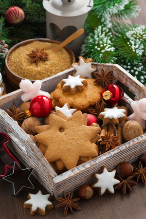 wooden box with Christmas cookies, spices and decorations, vertical, close-up, top view photo