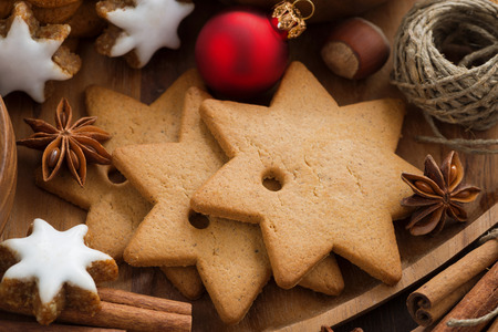 Assorted Christmas cookies, decorations and spices, close-up, horizontal photo