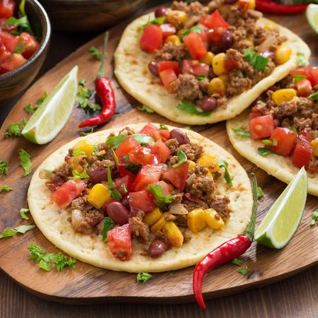 chili con carne in Mexican tortillas, close-up