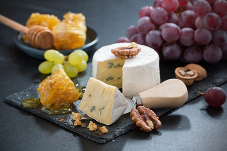 delicious Camembert with fresh honey and nuts, close-up photo