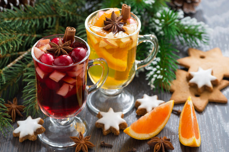 festive Christmas beverages, biscuits and spices on a wooden table, close-up photo