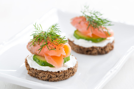 canape with cheese, cucumber and salmon, close-up Stock Photo