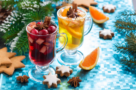 Christmas mulled wine and spiced apple cider on a blue background, horizontal photo