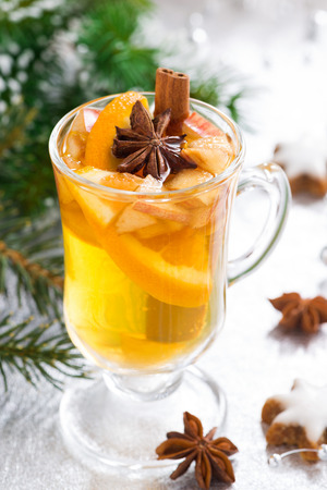 Spicy Christmas apple cider on a silver background, vertical Stock Photo