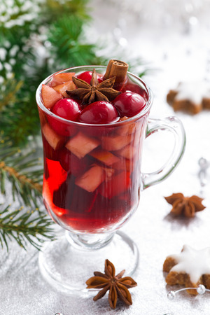 Spicy Christmas mulled wine on a silver background, vertical photo