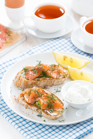 bread with salted salmon and cream cheese for breakfast photo