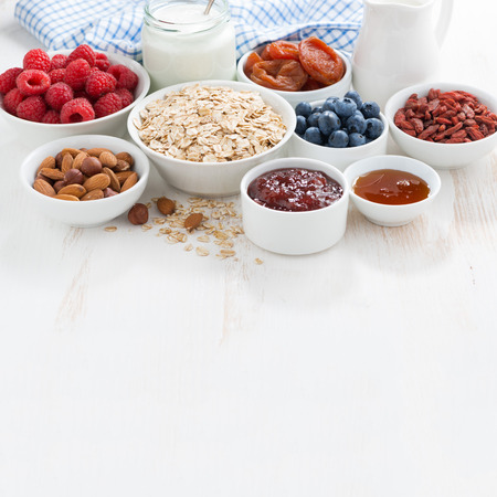 oat flakes, various ingredients for breakfast on wooden background and place for your text,