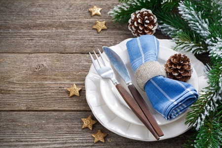 Christmas table setting on a wooden background, horizontal, top view, close-up