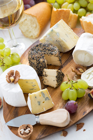 cheese platter, snacks, bread and wine, vertical, top view photo