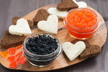festive appetizer - toasts, red and black caviar, horizontal photo