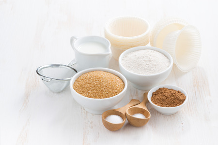 baking: Ingredients for baking muffins on white wooden table, close-up