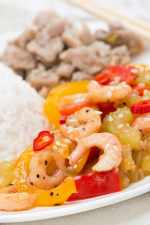 rice, chicken and vegetables with shrimp, close-up, vertical photo