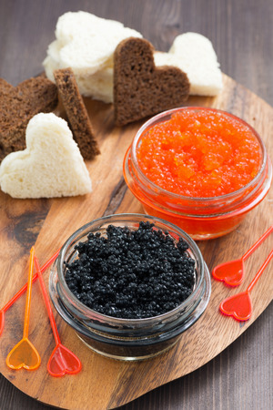 festive appetizer - toasts, red and black caviar, top view, vertical photo