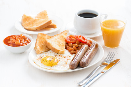 breakfast eggs: delicious English breakfast with sausages, horizontal Stock Photo