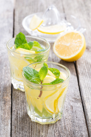 recipe decorated: refreshing mint lemonade on a wooden table, vertical, close-up Stock Photo