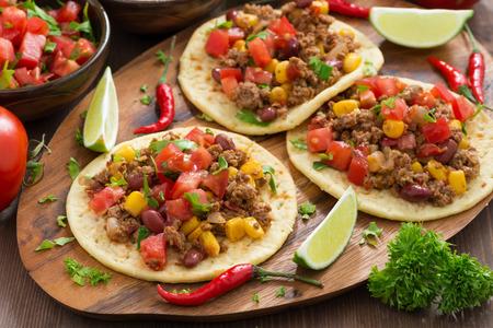 Mexican cuisine - tortillas with chili con carne and tomato salsa, horizontal Stockfoto