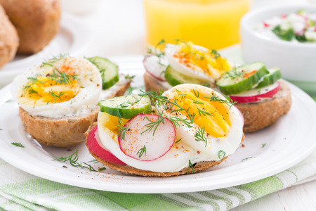 breakfast plate: buns with egg and vegetables for breakfast, close-up, horizontal Stock Photo