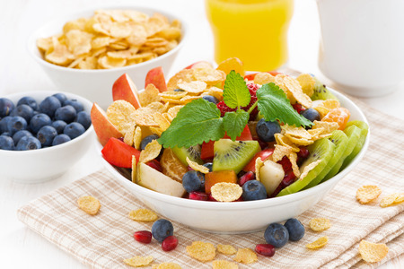 delicious fruit and berry salad for breakfast, close-up, horizontal Standard-Bild