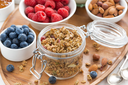 nutrition health: glass jar with homemade granola and berries, top view
