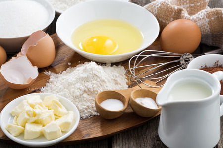 Baking ingredients on a wooden board, horizontal, close-up