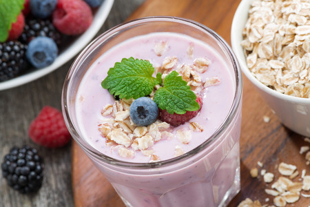 delicious berry smoothies with oatmeal, close-up, top view, horizontal photo