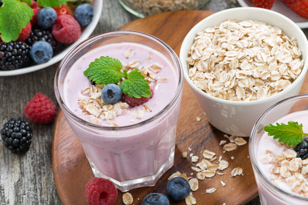 delicious berry smoothies with oatmeal in a glass, close-up
