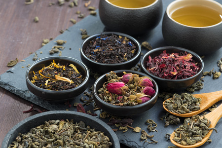 assortment of fragrant dried teas and green tea, close-up, horizontal
