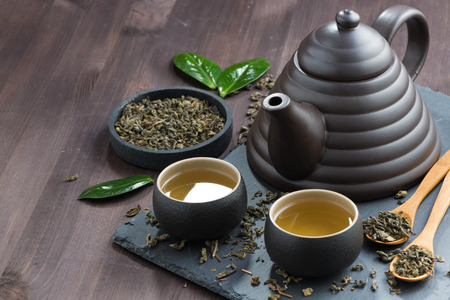 set for tea ceremony on a wooden table, horizontal Stockfoto