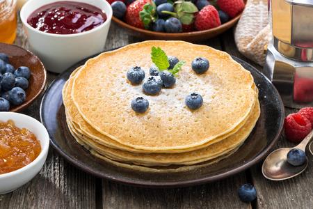 jams: crepes, fresh berries and jams, close-up, horizontal