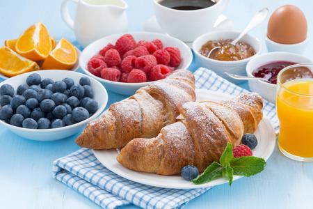 jams: Breakfast with croissants jams fresh berries and orange juice