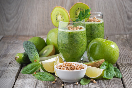 cucumbers: healthy green smoothie with sprouts on a wooden table, close-up
