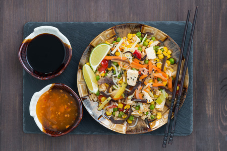 fast eat: fried rice with tofu and vegetables, top view, horizontal