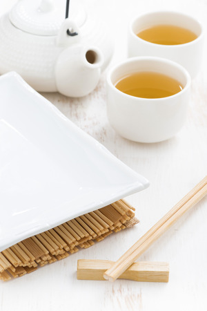 japanese meal: table setting for a Japanese meal on a white wooden background, vertical, close-up Stock Photo