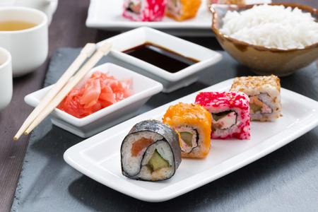 SUSHI: Japanese meal - sushi and rolls, horizontal Stock Photo