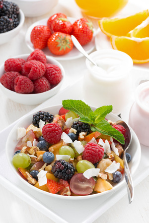 fruit: fruit salad in a bowl and various yoghurt