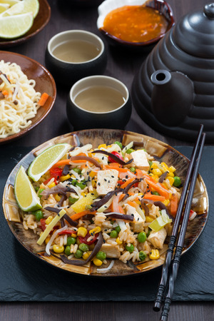 the corn salad: asian lunch - fried rice with tofu and vegetables, vertical, close-up