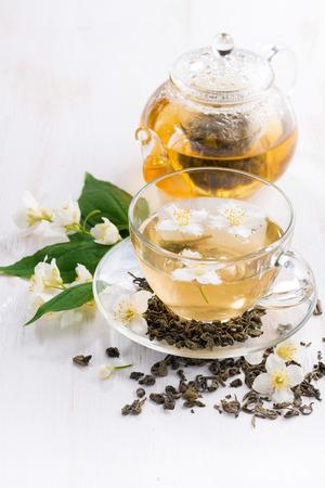 green tea with jasmin on wooden table