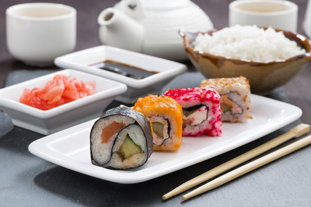 japanese meal: Japanese meal - sushi and rolls, close-up, horizontal Stock Photo