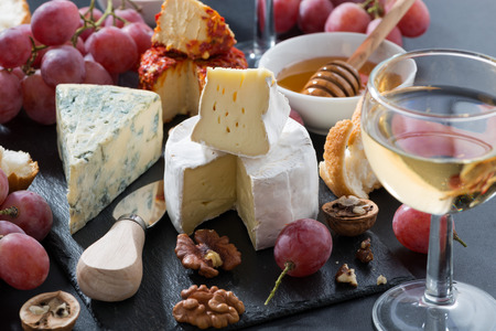 food and drink: molded cheeses, wine and snacks, closeup