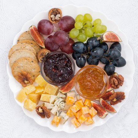Fruit plate: cheese and fruit plate, closeup