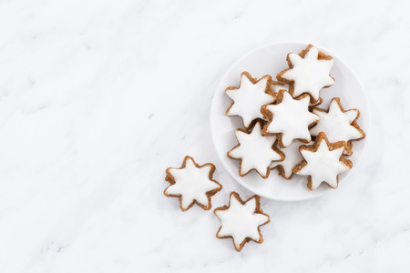 gingerbread cookies: Christmas cookies stars on a white background, top view, horizontal