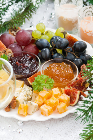 fruit plate: delicacy cheese and fruit plate closeup vertical, top view