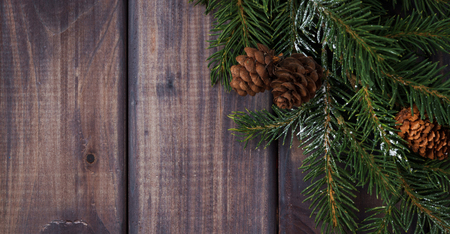 holiday decor: dark wood background with fir branches, horizontal Stock Photo