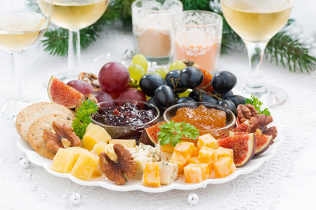 obstteller: delicacy cheese and fruit plate to the holiday, horizontal