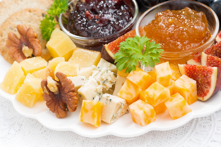 obstteller: delicious cheese and fruit plate to the holiday, closeup, horizontal