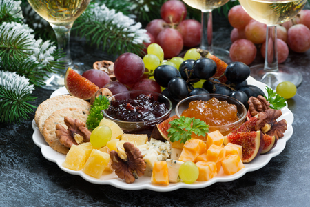 christmas party: appetizers to the holiday - cheeses, fruits and jams, horizontal