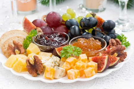 christmas catering: delicious cheese and fruit plate to the holiday, closeup Stock Photo